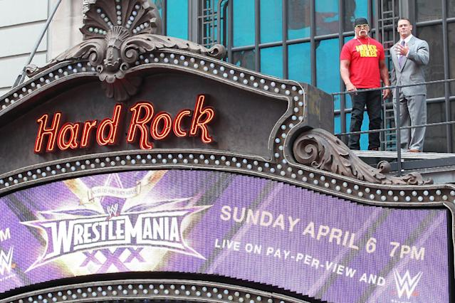This image released by Starpix shows professional wresting personalities Hulk Hogan, left, and John Cena on top of the The Hard Rock Cafe during a news conference for Wrestlemania 30 on Tuesday, April 1, 2014 in New York. Wrestlemania 30 will be held on Sunday, April 6 in New Orleans . (AP Photo/Starpix, Dave Allocca) -PICTURED: Hulk Hogan and John Cena -PHOTO by: Dave Allocca/Starpix -File name: DA_14_701546.JPG -Location: The Hard Rock Cafe Editorial - Rights Managed Image - Please contact www.startraksphoto.com for licensing fee Startraks Photo New York, NY For licensing please call 212-414-9464 or email sales@startraksphoto.com