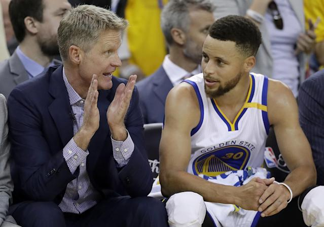 Steve Kerr (left) had missed the Warriors' previous 11 playoff games before returning for Game 2 of the NBA Finals. (AP)