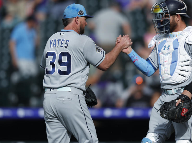San Diego Padres relief pitcher Kirby Yates, left, is congratulated by catcher Austin Allen after retiring Colorado Rockies' Nolan Arenado for the final out in the ninth inning of a baseball game Sunday, June 16, 2019, in Denver. (AP Photo/David Zalubowski)