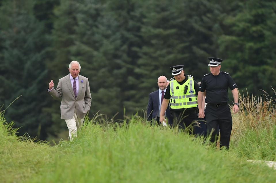 Charles at the scene at Stonehaven close to where a train derailed this week. (PA)