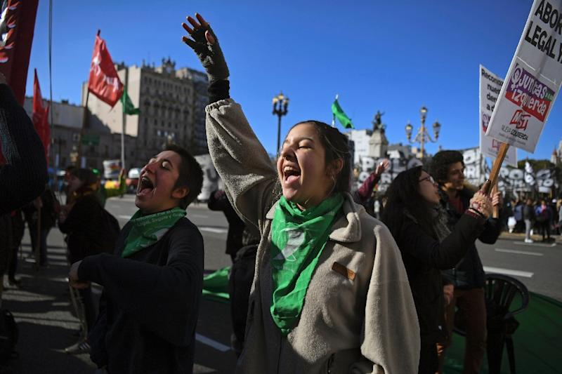 People in favor of the legalization of abortion demonstrate outside the National Congress in Buenos Aires
