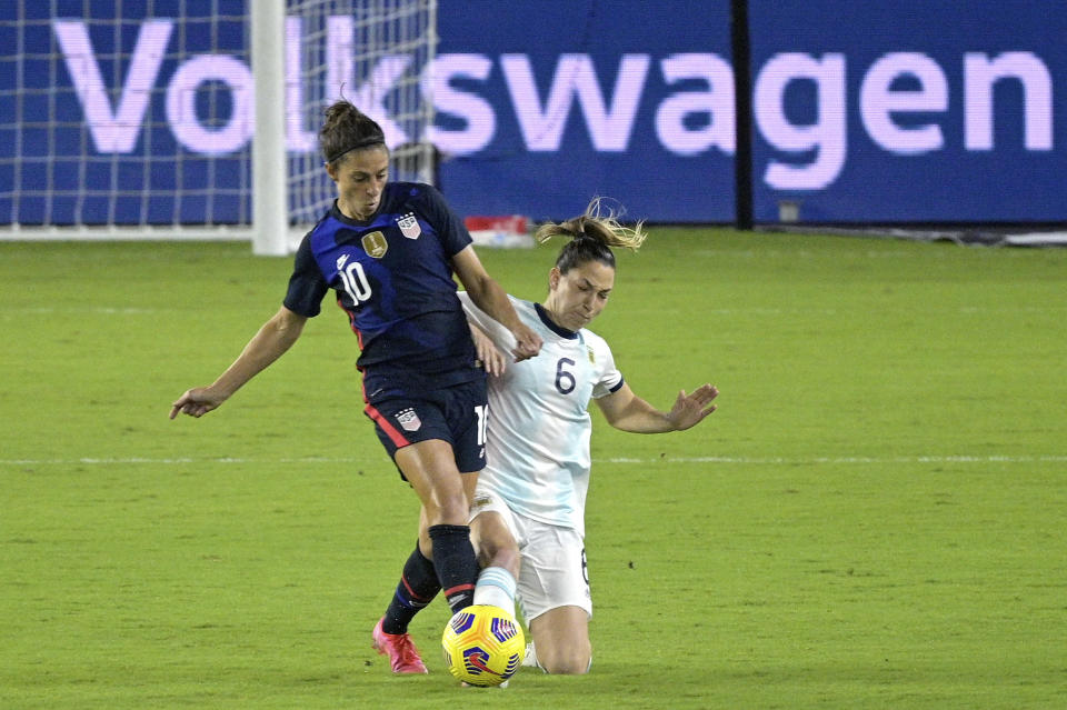 United States forward Carli Lloyd (10) and Argentina defender Aldana Cometti (6) compete for a ball during the first half of a SheBelieves Cup women's soccer match, Wednesday, Feb. 24, 2021, in Orlando, Fla. (AP Photo/Phelan M. Ebenhack)