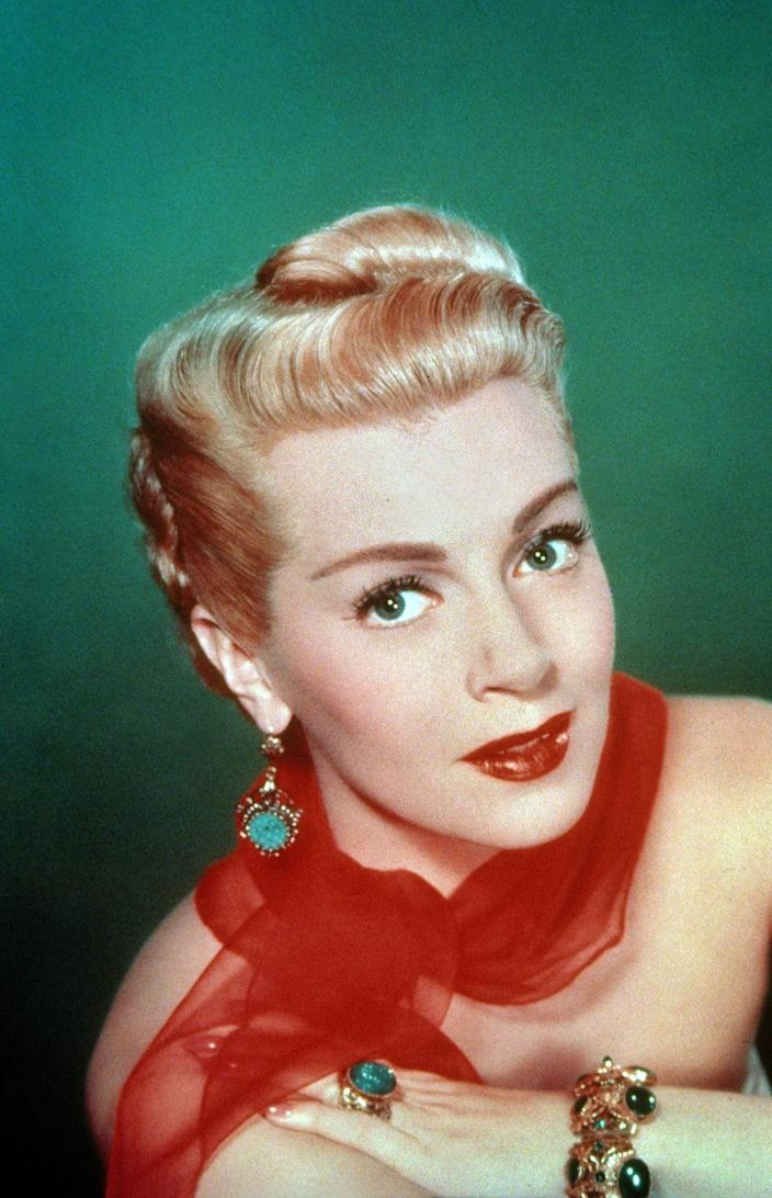 """<p>A trend that carried over from the '40s, victory rolls were tight and voluminous curls set on the top of the head for a sleek and sophisticated look. Actresses like Lana Taylor wore this look when they wanted to add a touch of glamour. </p><p><strong>RECOMMENDED:</strong> <a href=""""https://www.goodhousekeeping.com/beauty/hair/g3471/most-popular-hairstyles-of-all-time/"""" rel=""""nofollow noopener"""" target=""""_blank"""" data-ylk=""""slk:The Trendiest Hairstyle the Year You Were Born"""" class=""""link rapid-noclick-resp"""">The Trendiest Hairstyle the Year You Were Born</a></p>"""
