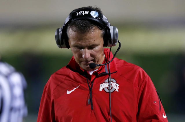 Ohio State head coach Urban Meyer walks the sidelines during the first half of an NCAA football game against Northwestern, Saturday, Oct. 5, 2013, in Evanston, Ill. (AP Photo/Charles Rex Arbogast)