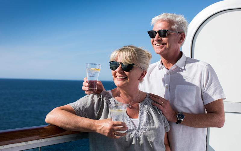 Phillip Schofield and his wife Steph take in the sea views