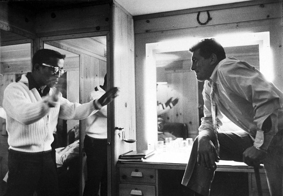 """<p>Dean Martin and Sammy Davis Jr. goof around in a dressing room in 1958. Martin's nickname was """"The King of Cool.""""</p>"""