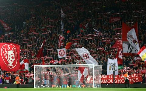 iverpool fans wave flags ahead of the Champions League Group C soccer match between Liverpool and Paris-Saint-Germain - Credit: AP