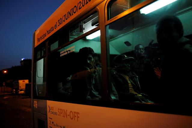 Migrants, part of a group intercepted aboard dinghies off the coast in the Mediterranean Sea, are seen in a bus towards a sports center after arriving on a rescue boat at the port of Malaga, Spain June 23, 2018. REUTERS/Jon Nazca TPX IMAGES OF THE DAY