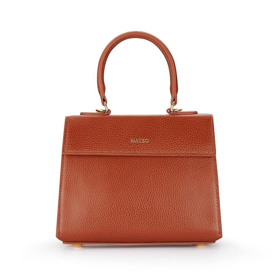 """<p><strong>Mateo</strong></p><p>mateonewyork.com</p><p><strong>$350.00</strong></p><p><a href=""""https://mateonewyork.com/collections/bags/products/cognac-elizabeth-bag"""" rel=""""nofollow noopener"""" target=""""_blank"""" data-ylk=""""slk:Shop Now"""" class=""""link rapid-noclick-resp"""">Shop Now</a></p><p>From masks to phone chargers, this compact bag will hold all her essentials for when she does venture outdoors. </p>"""