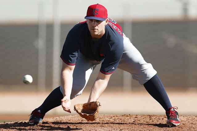 Cleveland Indians pitcher Justin Masterson fields a ground ball during spring training baseball practice in Goodyear, Ariz., Thursday, Feb. 13, 2014. (AP Photo/Paul Sancya)