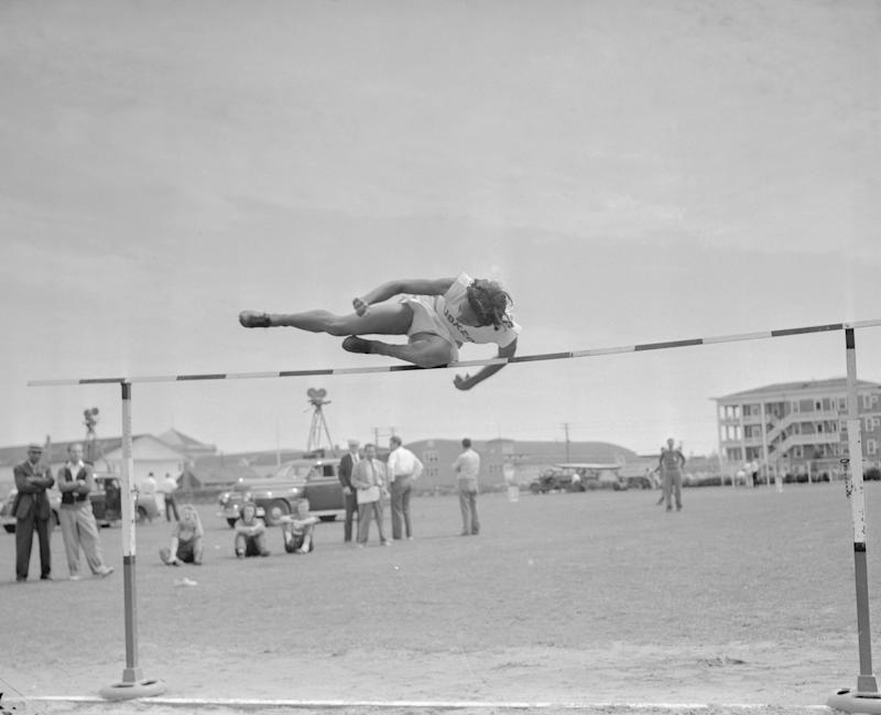 Alice Coachman of Tuskegee, Alabama Institute clears the bar in the running high jump at the Women's National A.A.U. track and field championships in Ocean City. She won with a leap of 5 feet, 2 3/4 inches to retain her title. (Photo by Getty)