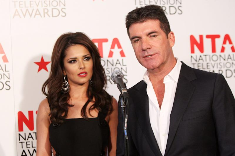 LONDON, ENGLAND - JANUARY 26: Cheryl Cole and Simon Cowell pose in front of the winners boards at the National Television Awards 2011 held at Indigo at The O2 Arena on January 26, 2011 in London, England. (Photo by Dave Hogan/Getty Images)