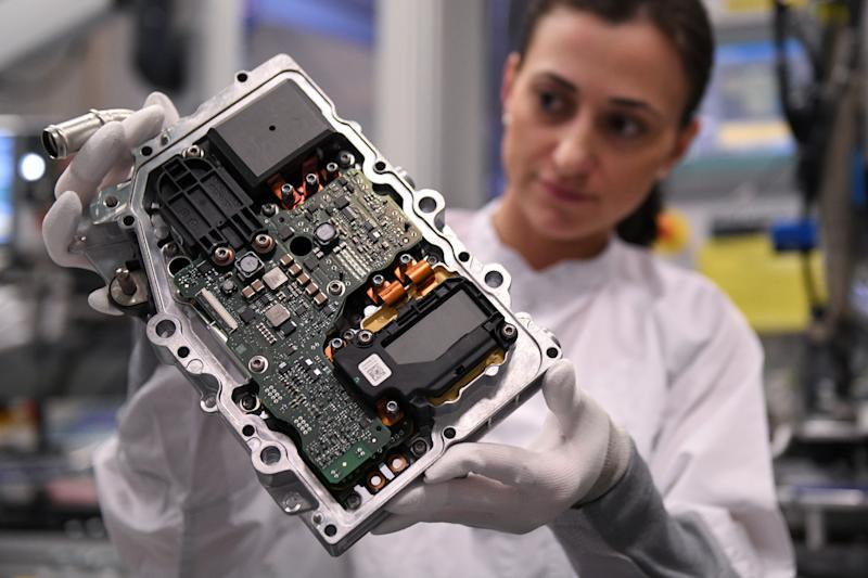 An employee of German car parts maker Continental inspects a power electronics component at the factory of the company's Powertrain unit in Nuremberg, Germany, March 1, 2019. Picture taken March 1, 2019. REUTERS/Andreas Gebert