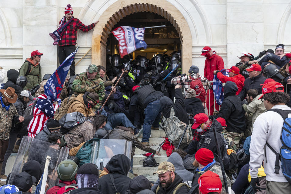 Rioters clash with police trying to enter Capitol building through the front doors on Jan. 6, 2021. (Lev Radin/Pacific Press/LightRocket via Getty Images)