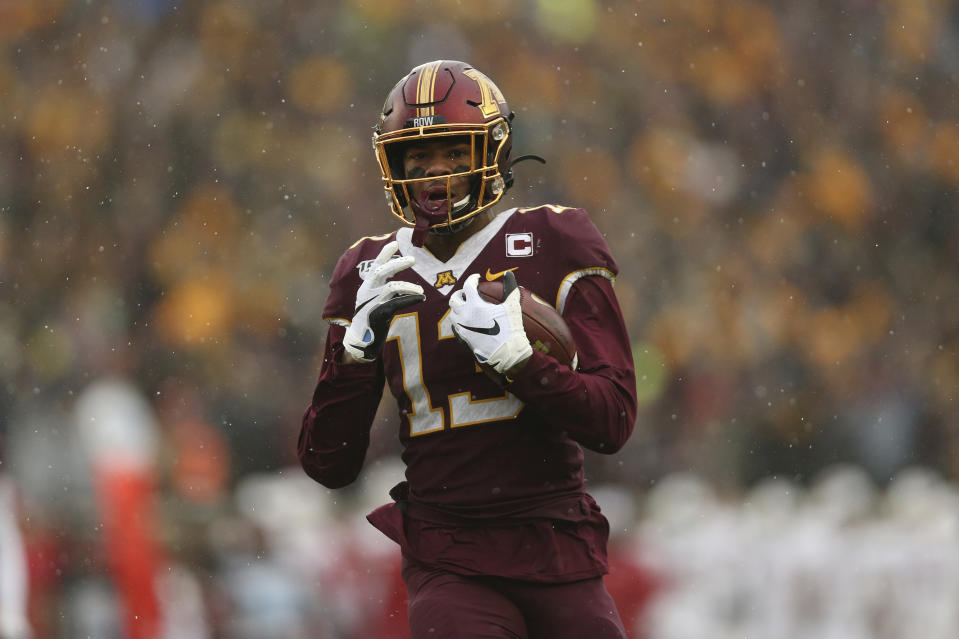 Minnesota wide receiver Rashod Bateman (13) carries the ball into the end zone for a touchdown against Wisconsin during the first half of an NCAA college football game Saturday, Nov. 30, 2019, in Minneapolis. (AP Photo/Stacy Bengs)