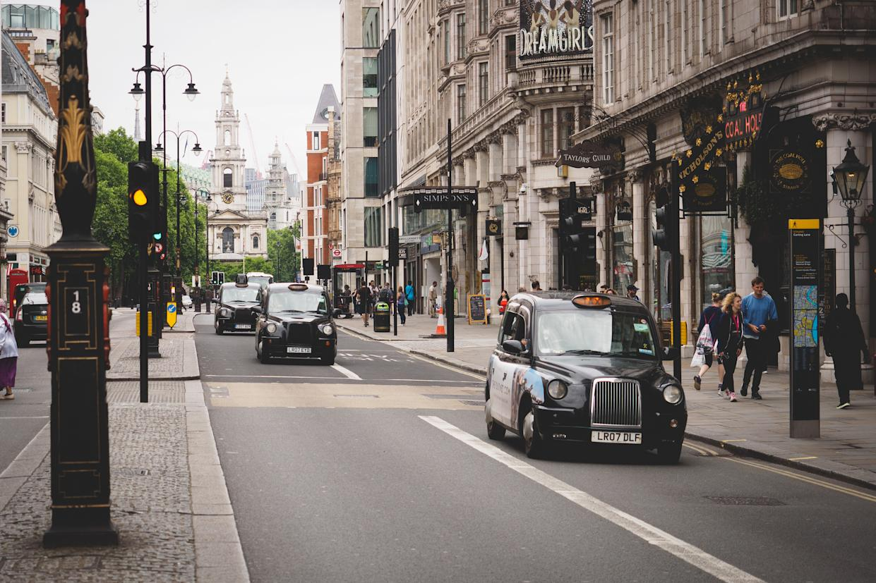 London, UK - February, 2018. Typical black cabs on the Strand. Landscape format.