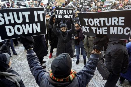 FILE PHOTO: Protesters attend a rally at Metropolitan Detention Center demanding that heat is restored for the inmates in the Brooklyn borough of New York City, New York, U.S., February 2, 2019. REUTERS/Go Nakamura/File Photo