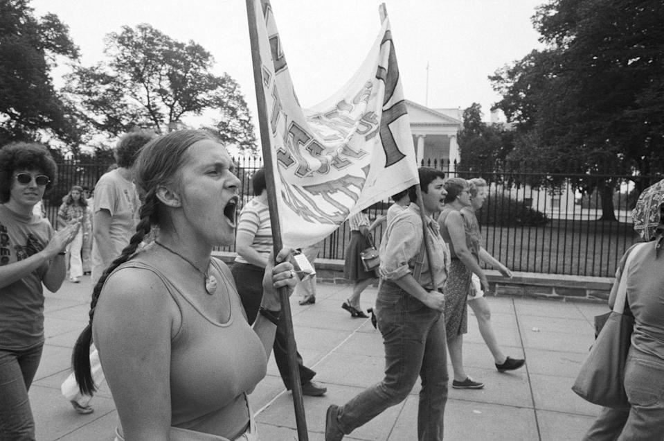 """<p>Feminists also protested in Washington, D.C., in favor of the Equal Rights Amendment. Here, a group of activists carried a banner past the White House advocating the amendment's passage. Leaders of the pro-ERA movement included <a href=""""https://www.townandcountrymag.com/leisure/arts-and-culture/a32131889/gloria-steinem-ms-magazine-true-story/"""" rel=""""nofollow noopener"""" target=""""_blank"""" data-ylk=""""slk:Gloria Steinem"""" class=""""link rapid-noclick-resp"""">Gloria Steinem</a>, <a href=""""https://www.townandcountrymag.com/leisure/arts-and-culture/g32142861/shirley-chisholm-1972-presidential-campaign-photos/"""" rel=""""nofollow noopener"""" target=""""_blank"""" data-ylk=""""slk:Shirley Chisholm"""" class=""""link rapid-noclick-resp"""">Shirley Chisholm</a>, and Betty Friedan. </p>"""