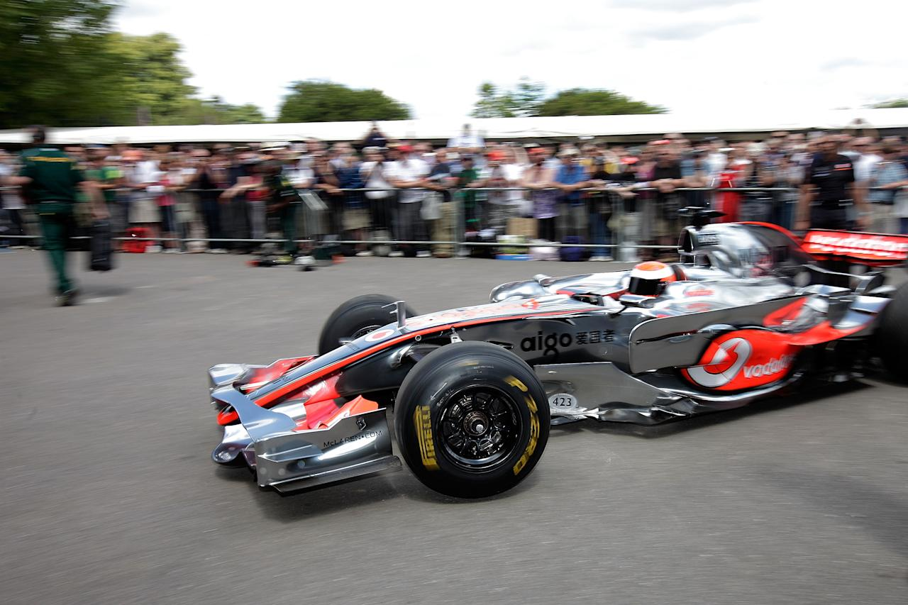 CHICHESTER, ENGLAND - JULY 01:  The Mclaren Mercedes car leaves the assembly area for a run at the Goodwood Festival of Speed on July 1, 2011 in Chichester, England. Drivers compete in a variety of cars, from vintage models to modern Formula 1 cars in the annual hill climb.  (Photo by Matthew Lloyd/Getty Images)