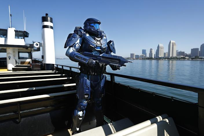 """Shane Holly dressed as Spartan 2296 from the video game Halo on board the Flagship Cruises Cabrillo in San Diego Bay. A number of Comic-Con regulars cited the cosplay as the aspect of the event they miss most this year. <span class=""""copyright"""">(K.C. Alfred/The San Diego Union-Tribune)</span>"""