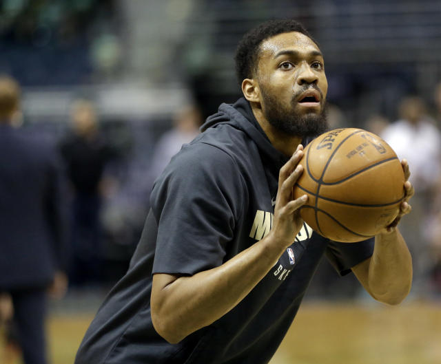 Jabari Parker shoots during warmups against the Miami Heat on Jan. 17. (AP)