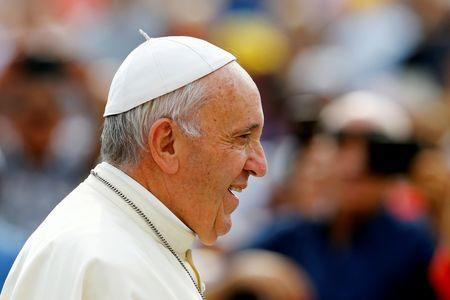 Pope Francis arrives to leads the weekly audience at the Vatican
