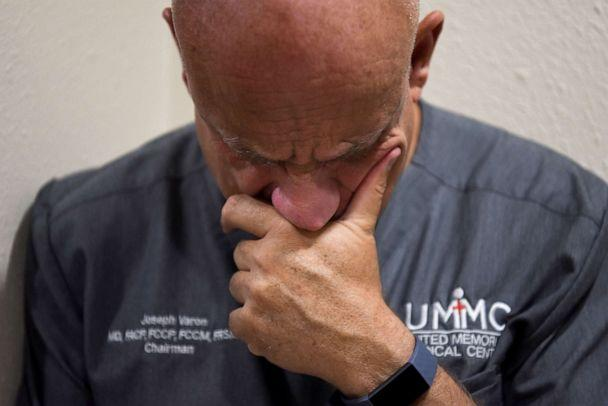 PHOTO: Dr. Joseph Varon, 58, the chief medical officer at United Memorial Medical Center (UMMC), checks his phone after getting home from work, during the coronavirus disease (COVID-19) outbreak,  in Houston, Texas, July 20, 2020. (Callaghan O'hare/Reuters)