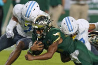 South Florida running back Brian Battie (21) is taken down by Citadel defensive back Destin Mack (7) and defensive back Chris Beverly (17) during the second half of an NCAA college football game Saturday, Sept. 12, 2020, in Tampa, Fla. (AP Photo/Chris O'Meara)