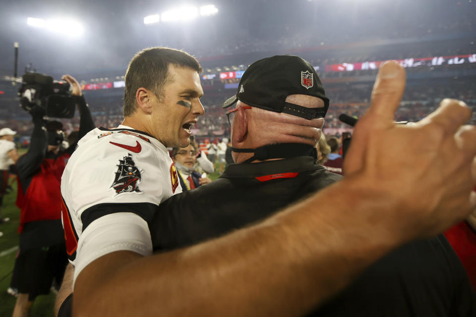 Tampa Bay Buccaneers quarterback Tom Brady (12) celebrates with head coach Bruce Arians following the NFL Super Bowl 55 football game against the Kansas City Chiefs, Sunday, Feb. 7, 2021 in Tampa, Fla. Tampa Bay won 31-9. (Ben Liebenberg via AP)