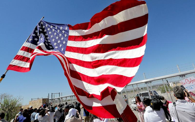 Protesters outside a tented migrant's shelter in Texas - AP