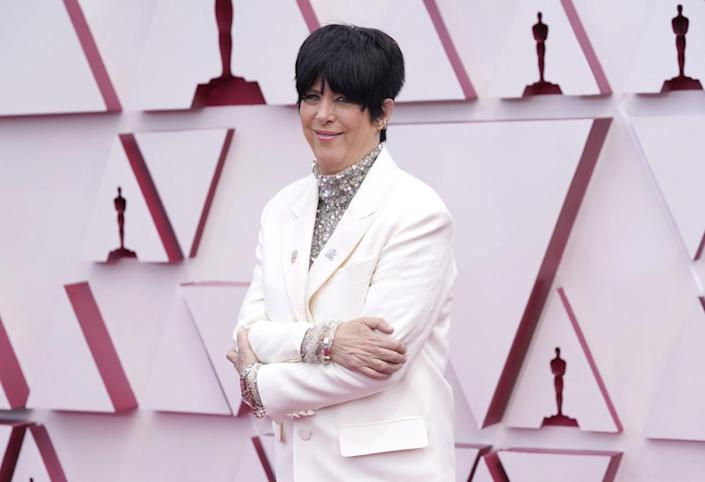 Diane Warren in a Valentino suit with a sparkly turtleneck arrives at the Oscars.