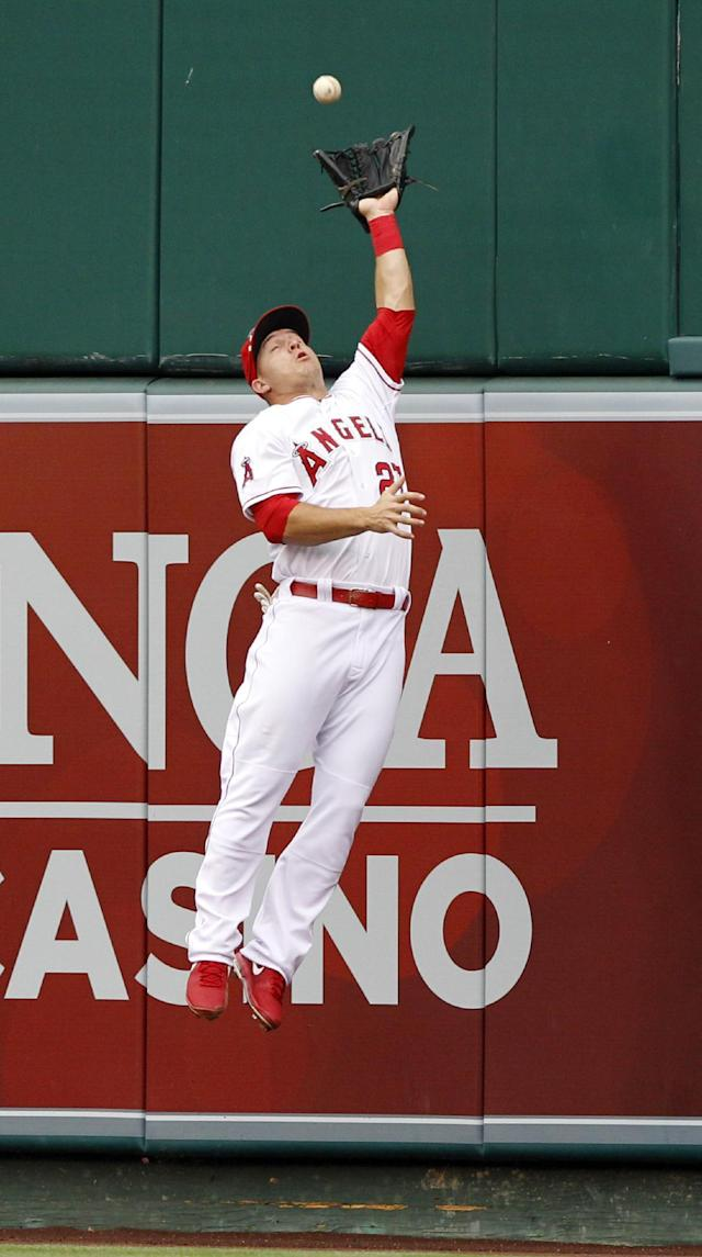 Los Angeles Angels center fielder Mike Trout leaps to catch a fly ball hit by Kansas City Royals designated hitter Billy Butler in the fourth inning of a baseball gamew Saturday, May 24, 2014, in Anaheim, Calif. (AP Photo/Alex Gallardo)
