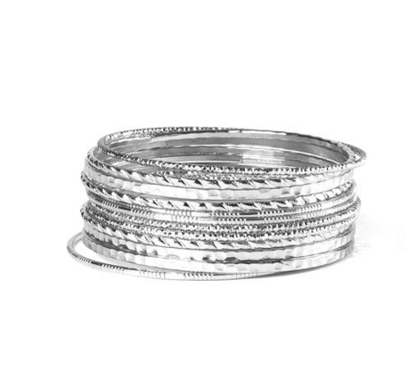 """<p>Clarie's Silver Textured Bangle Bracelets (Set of 12), $7, <a href=""""http://www.claires.com/us/products/silver-textured-bangle-bracelets-set-of-12-87324"""" rel=""""nofollow noopener"""" target=""""_blank"""" data-ylk=""""slk:Clarie's."""" class=""""link rapid-noclick-resp"""">Clarie's. </a><br></p>"""