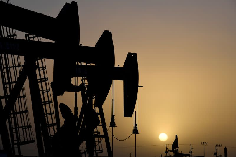 Oil prices claw back losses as storage fills less rapidly than feared