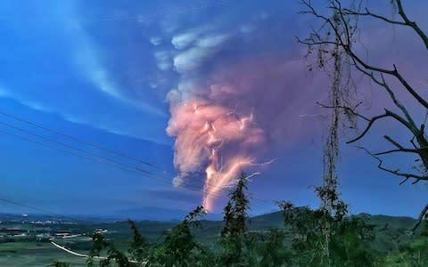<span>Lightning streak over Batangas as Taal Volcano continues its eruption on Sunday evening.</span> <span>Credit: Alamy </span>