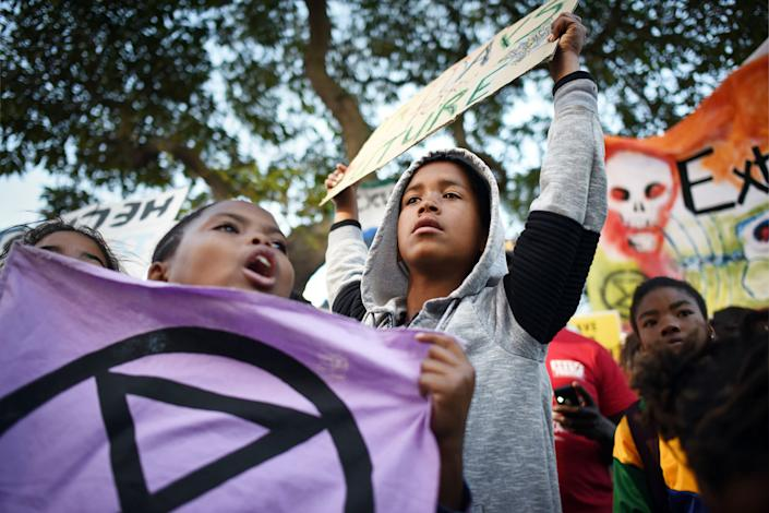Young XR activists demonstrate outside South Africa's Parliament in Cape Town on June 1. | Rodger Bosch—AFP/Getty Images