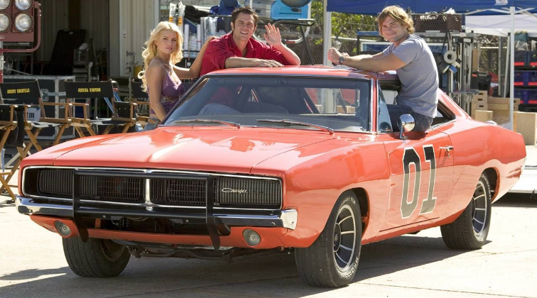 "<p>Unlike <em>Starsky & Hutch,</em> which is set in the same time period as the TV show, this movie is set in present day. At the beginning of the movie, the car is a faded orange with a hand-painted ""01,"" black steel wheels, a standard front bumper, and no Confederate flag on the roof. Halfway through the film The General undergoes a transformation after being vandalized: Cooter repaints it a bright ""Hemi"" orange, adds ten-spoke turbine wheels, the octagonal ""01,"" a black grille guard, the flag, a ""Dixie"" horn, and the ""General Lee"" above the door openings.</p><p>Reportedly, two dozen 1968-70 Chargers were used for the film, though most of them didn't survive the stunt-packed scenes. Again separating itself from the show, the movie cars used aftermarket graphics kits, but overall they vary little from the original General Lees. One of the TV cars did make an appearance in the film as a close-up car. It was used for a few scenes and then sent back to Warner Bros. </p><p>In the aftermath of the 2015 Charleston, South Carolina, shooting deaths and the reignited resistance to the Confederate flag, Warner Bros. announced they would stop production of the General Lee toy cars.</p><p><a class=""link rapid-noclick-resp"" href=""https://www.amazon.com/gp/video/detail/0QOHSIW1BMF40B98HI9QFFCIF9/?tag=syn-yahoo-20&ascsubtag=%5Bartid%7C10054.g.27421711%5Bsrc%7Cyahoo-us"" rel=""nofollow noopener"" target=""_blank"" data-ylk=""slk:AMAZON"">AMAZON</a></p>"
