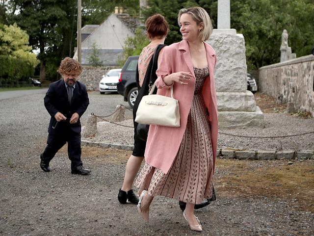 Actors Peter Dinklage and Emilia Clarke arrive at Rayne Church, Kirkton of Rayne in Aberdeenshire, for the wedding ceremony of their Game Of Thrones co-stars Kit Harington and Rose Leslie. (Photo by Jane Barlow/PA Images via Getty Images)