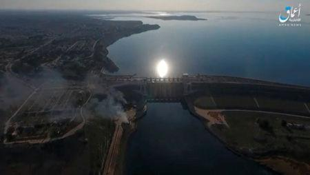 A still image taken from a video posted to a social media website by the Islamic State-affiliated Amaq News Agency on March 27, 2017, shows an aerial view of the Tabqa dam on the Euphrates river, said to be in Tabqa, Syria. Social Media Website via Reuters
