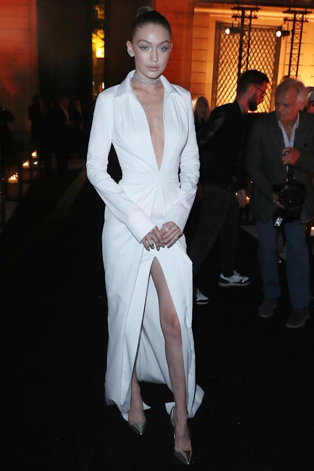 <p>In a white collared Brandon Maxwell gown with Messika by Gigi Hadid jewelry and metallic pumps at a Messika Jewelry launch party during Paris Fashion Week. </p>