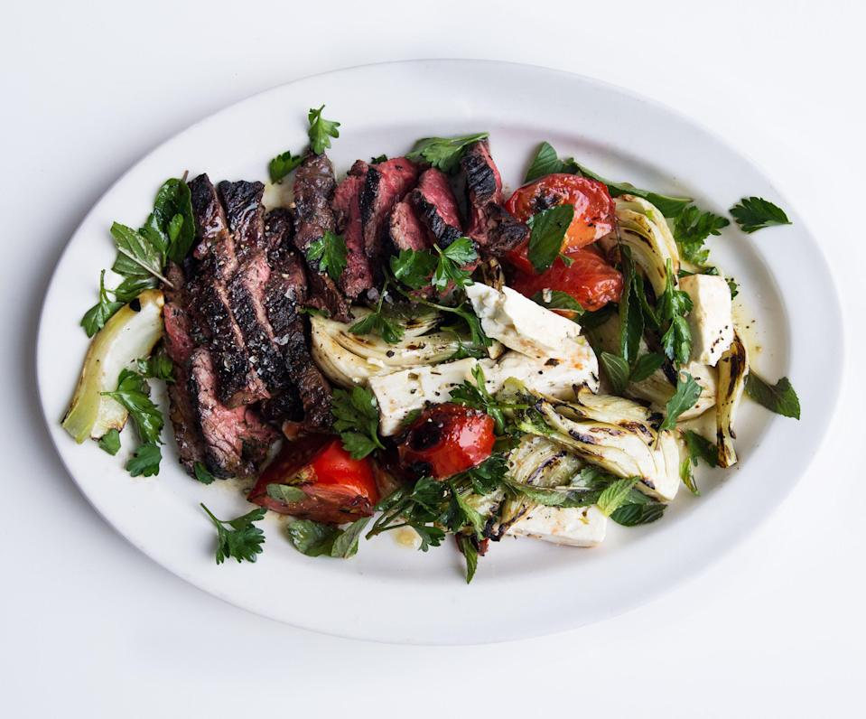 """51 Lincoln grills the tomatoes for this salad, but unless you have a screaming-hot grill, this can be tricky. Either way, use beefsteaks, which have an excellent ratio of flesh to seeds. <a href=""""https://www.bonappetit.com/recipe/grilled-hanger-steak-with-fennel-salad?mbid=synd_yahoo_rss"""" rel=""""nofollow noopener"""" target=""""_blank"""" data-ylk=""""slk:See recipe."""" class=""""link rapid-noclick-resp"""">See recipe.</a>"""