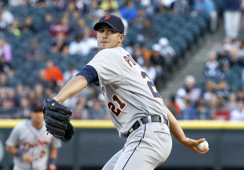 Detroit Tigers starting pitcher Rick Porcello delivers during the first inning of a baseball game against the Chicago White Sox Tuesday, July 23, 2013, in Chicago. (AP Photo/Charles Rex Arbogast)