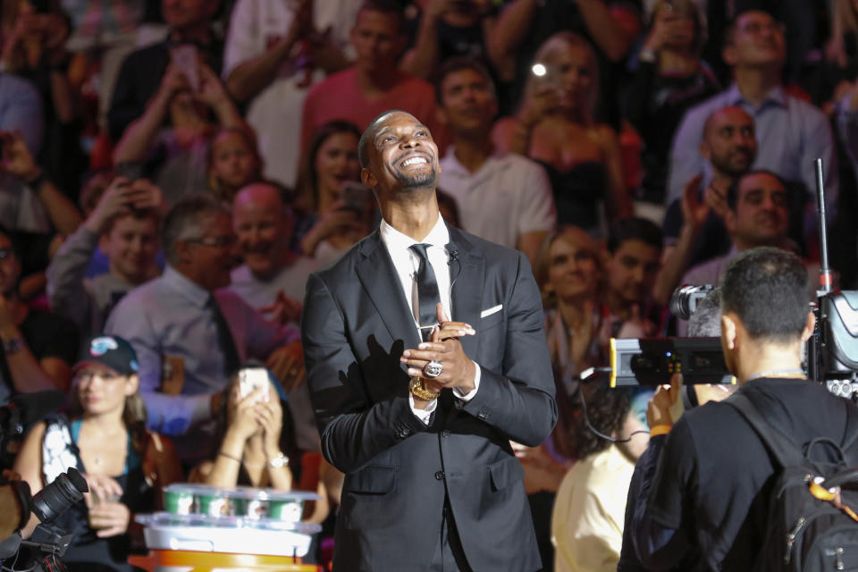 Former Miami Heat player Chris Bosh reacts after being introduced at the team's retirement of his jersey at halftime of an NBA game between the Heat and the Orlando Magic, Tuesday, March 26, 2019, in Miami. Bosh played 13 seasons, the first seven in Toronto and the last six in Miami. He averaged 19.2 points and 8.5 rebounds, was an All-Star 11 times and won two championships.(AP Photo/Joe Skipper)