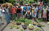 Indian farmers take vegetables in a rally at the Trinamool Congress Student cell during a protest against farm bills in Kolkata. (Photo by Dipa Chakraborty/Pacific Press/LightRocket via Getty Images)