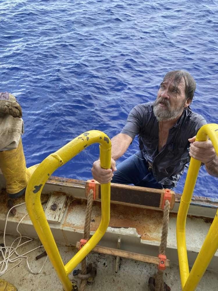 Stuart Bee boarding container ship Angeles after being stranded at sea.