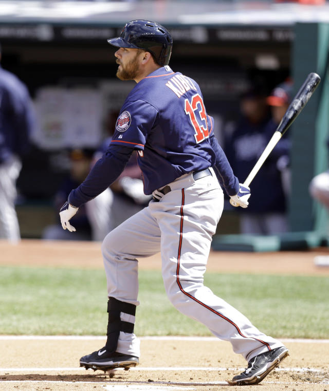 Minnesota Twins' Jason Kubel watches his ball after hitting an RBI single off Cleveland Indians starting pitcher Carlos Carrasco in the first inning of a baseball game, Saturday, April 5, 2014, in Cleveland. Josh Willingham scored. (AP Photo/Tony Dejak)