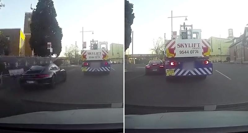 A Porsche overtakes a car before trying to overtake a crane which knocks into its driver's side door in Ivanhoe, Melbourne.
