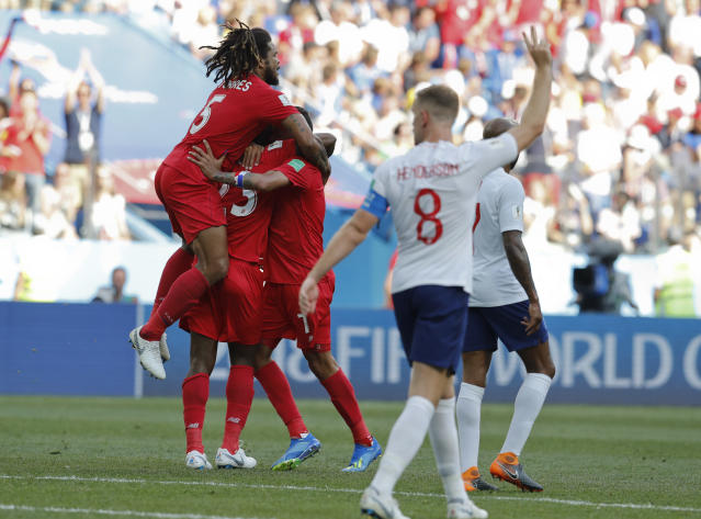 Panama players celebrate after their teammate Panama's Felipe Baloy scored during the group G match between England and Panama at the 2018 soccer World Cup at the Nizhny Novgorod Stadium in Nizhny Novgorod , Russia, Sunday, June 24, 2018. (AP Photo/Antonio Calanni)