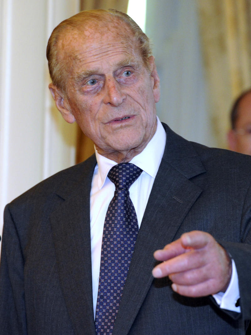 """File - Britain's Prince Philip arrives at Government House in Canberra, Australia,  in this Friday, Oct. 21, 2011 file photo.   Queen Elizabeth II's husband has been taken to the hospital after experiencing chest pains, British royal officials said Friday Dec 23, 2011. A spokeswoman for Buckingham Palace said Prince Philip was taken from Sandringham, the queen's sprawling estate in rural Norfolk, to the cardiac unit at Papworth Hospital in Cambridge for """"precautionary tests.""""  (AP Photo / Torsten Blackwood, Pool, file)"""
