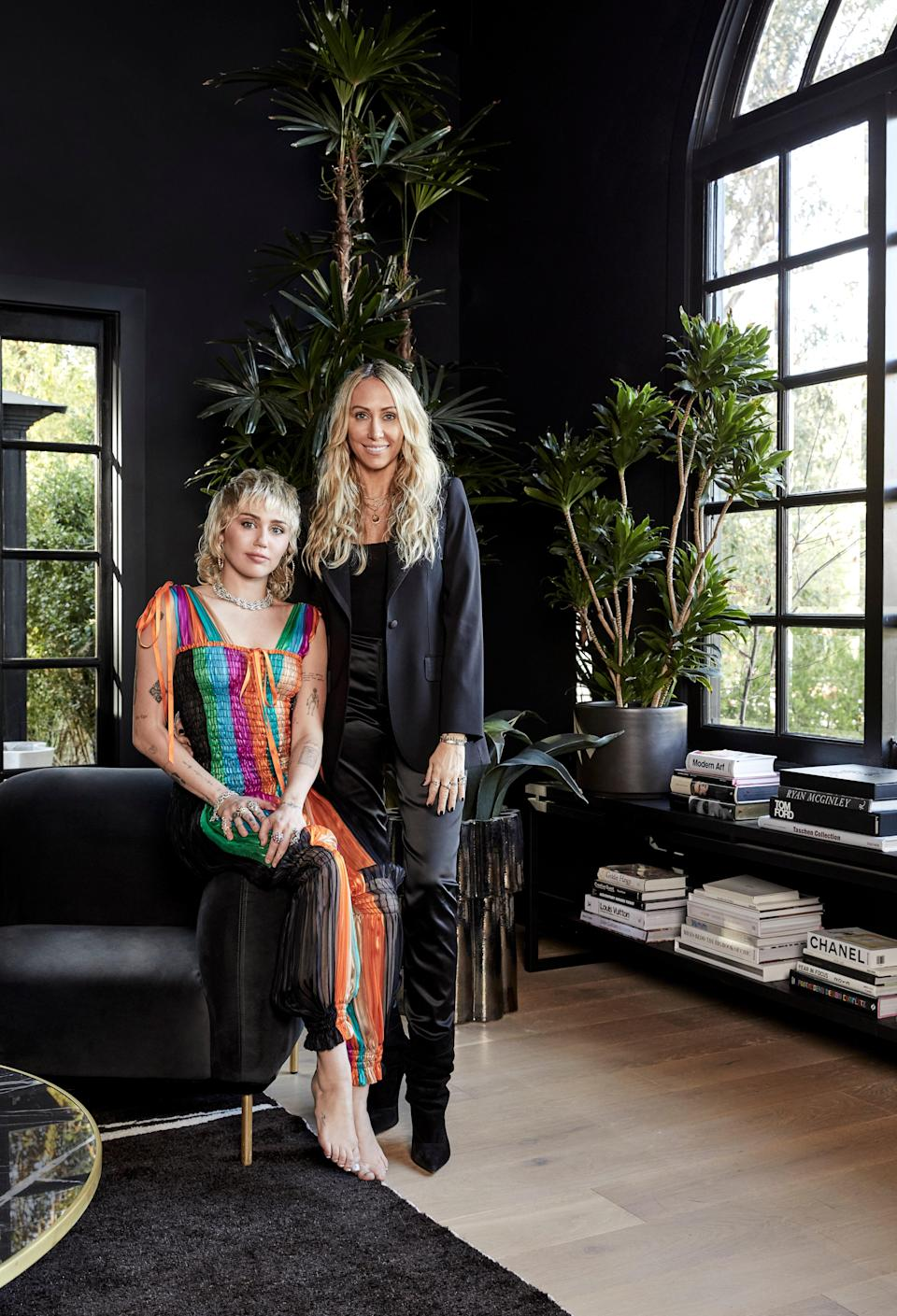 """We tried to keep the actual structure of the house simple, so that the furniture, the heart, the accessories, the photographs, they can really talk,"" says Miley, in vintage Yves Saint Laurent. Tish wears a Dolce & Gabbana jacket and J. Gerard pants."
